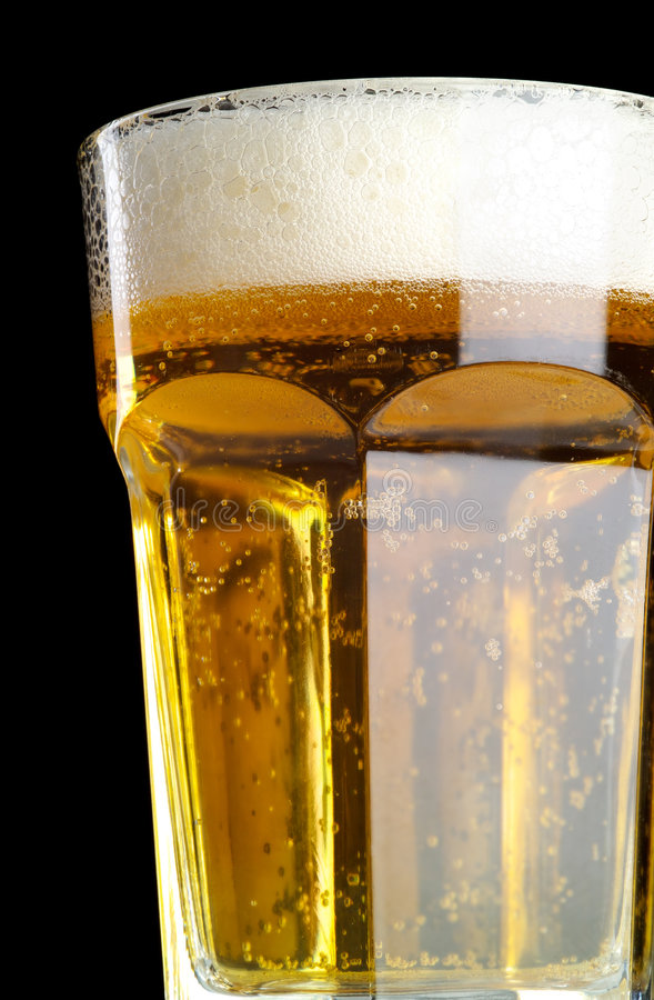 Fresh beer isolated on black royalty free stock photography
