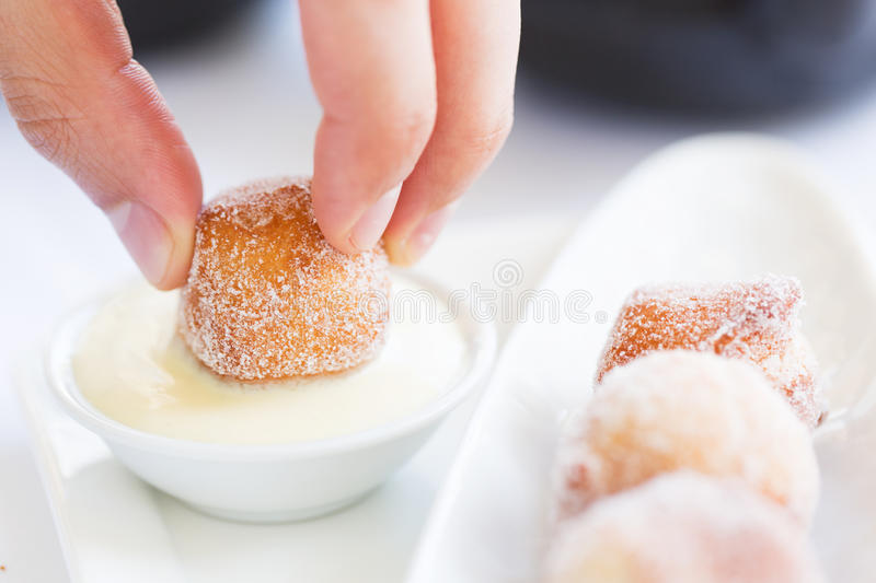 Fresh beignets with sauce royalty free stock image