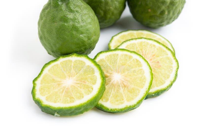 Fresh bergamot fruit with leaf on white background royalty free stock photos