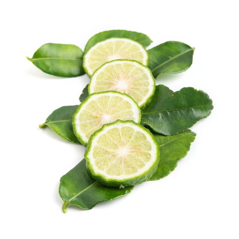 Fresh bergamot fruit with leaf on white background stock image