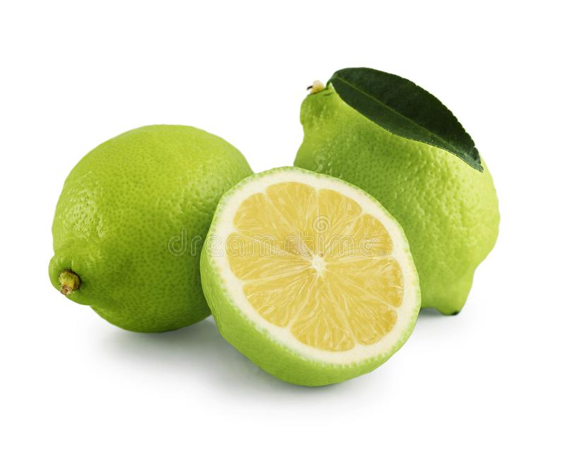Fresh bergamot orange with cut. And green leaves on white background with clipping path stock photo