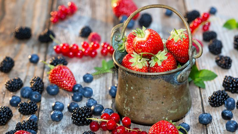 Fresh berries - antic pail full with strawberries. Selective focus. Banner stock photos