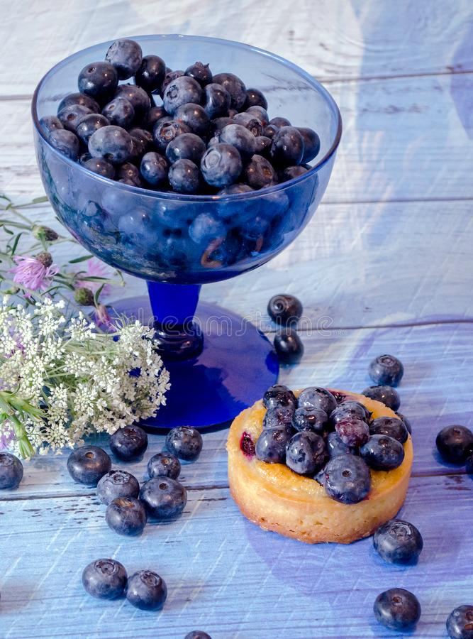 Fresh berries and cake with wildflowers stock photos
