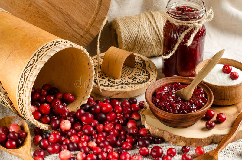 Fresh berries cranberry and jam cranberry royalty free stock photo