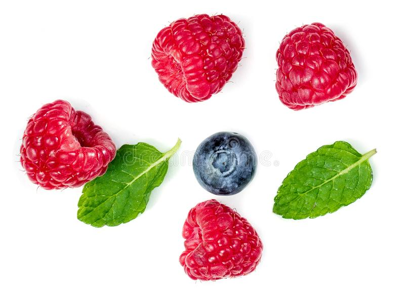 Fresh Berries mix isolated on white background. Raspberry, blueberry, mint leaf. Top view stock photos