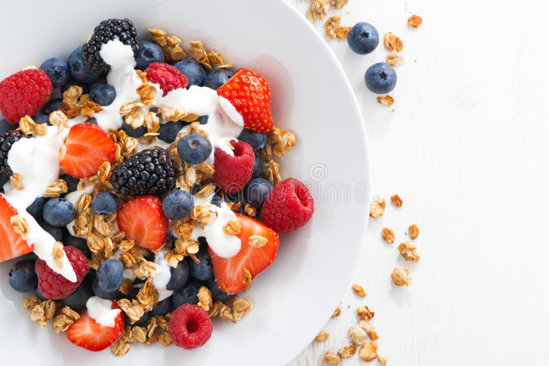 Fresh berries, yogurt and granola for breakfast. Fresh berries, yogurt and homemade granola for breakfast, close-up, top view, horizontal stock images