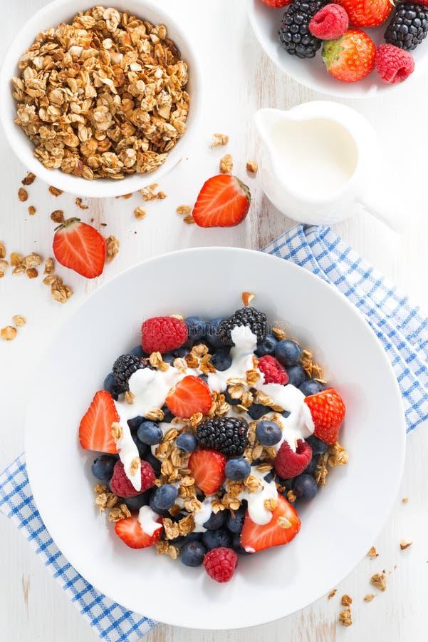 Fresh berries, yogurt and muesli for breakfast, top view. Vertical stock photos