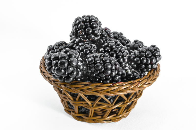Fresh blackberries in small basket stock photos