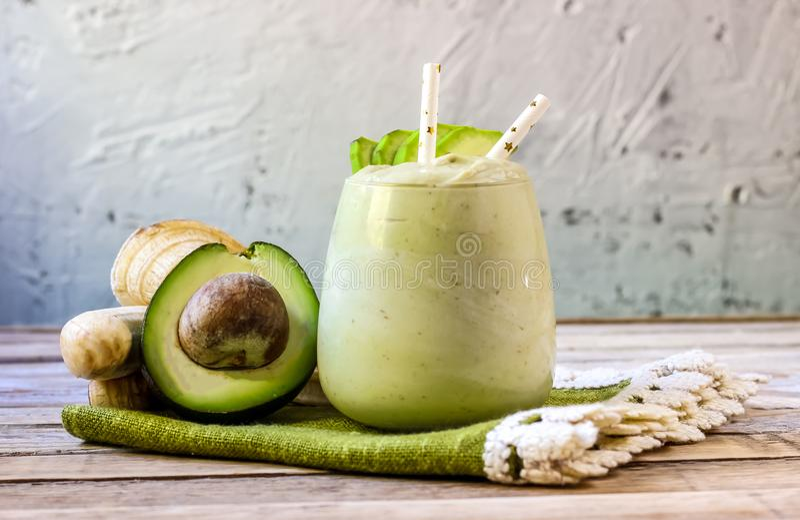 Fresh blended Banana and avocado smoothie royalty free stock photo