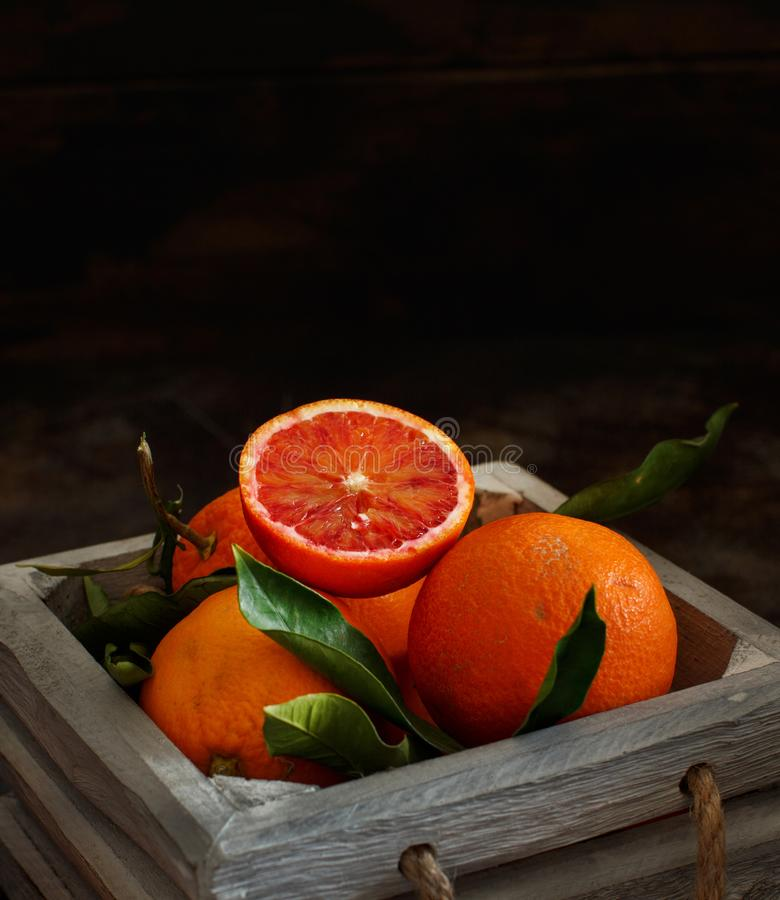 Free Fresh Bloody Oranges With Leaves Stock Photography - 109409622