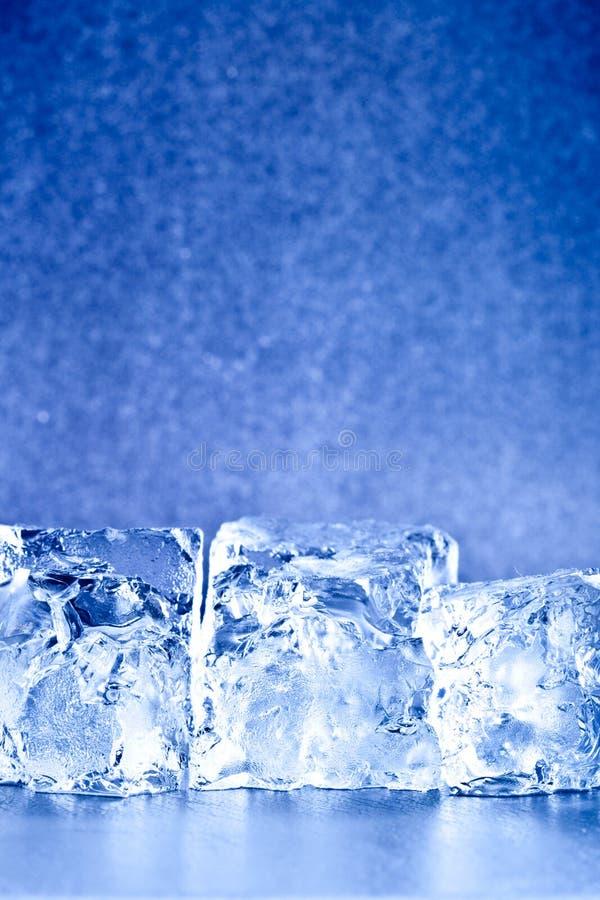 Fresh blue ice cubes background royalty free stock image