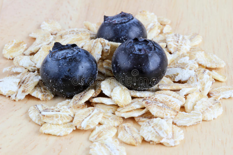 Download Fresh Blueberries With Oats On A Wooden Background Stock Photo - Image: 25136682