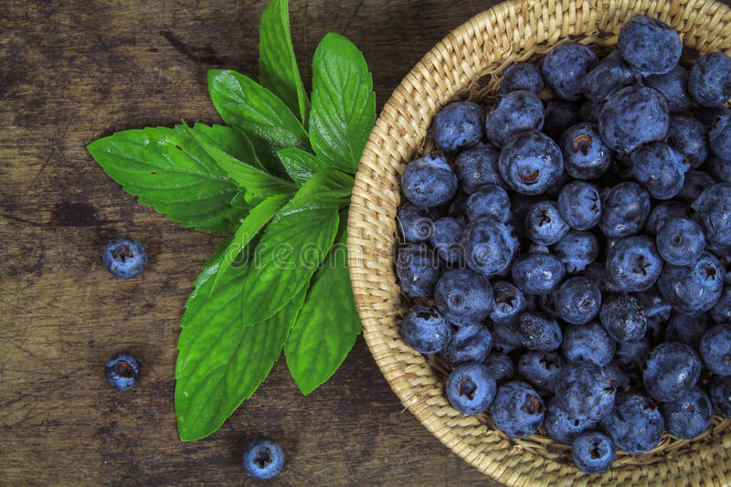 Fresh blueberry with leaf stock photography