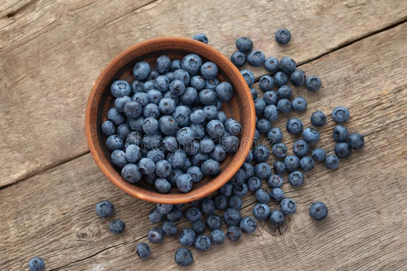 Fresh Blueberry on wooden background, close up royalty free stock photo