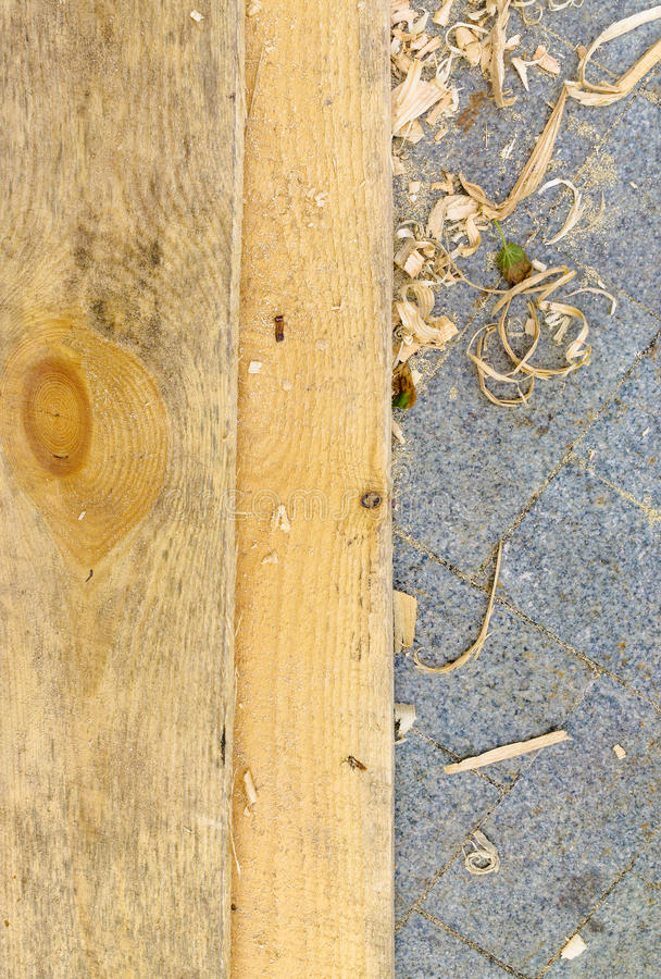 Fresh boards and wood shavings royalty free stock photography