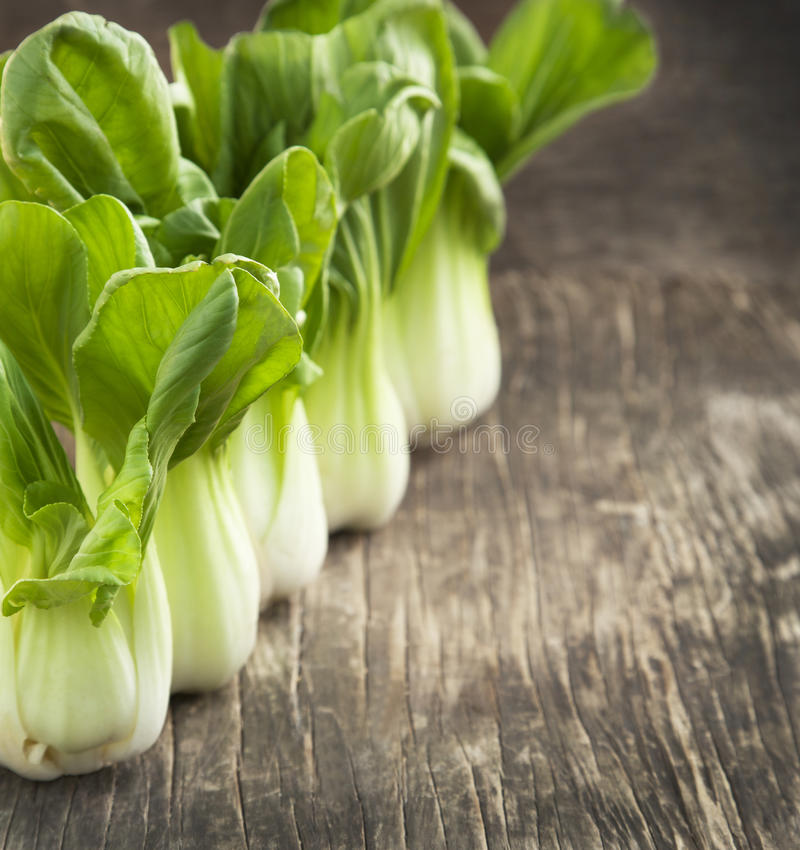 Fresh bok choy. On wooden background royalty free stock images