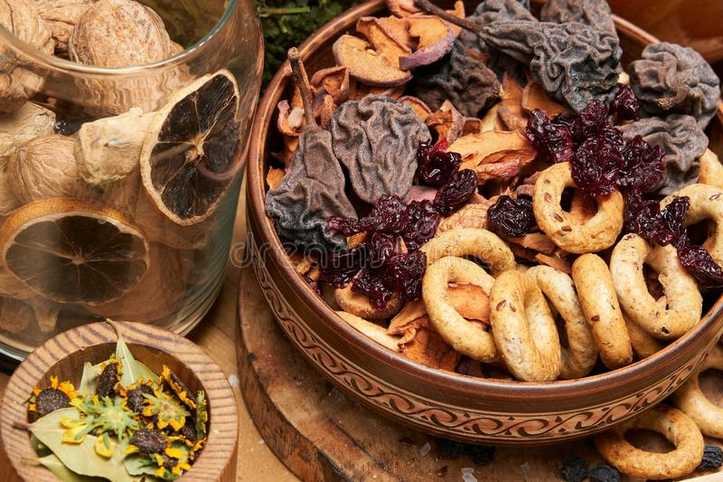 Fresh bread, bagels, dried fruits, seeds, salt, jar and wheat on the wooden - still life and healthy eating concept royalty free stock photography