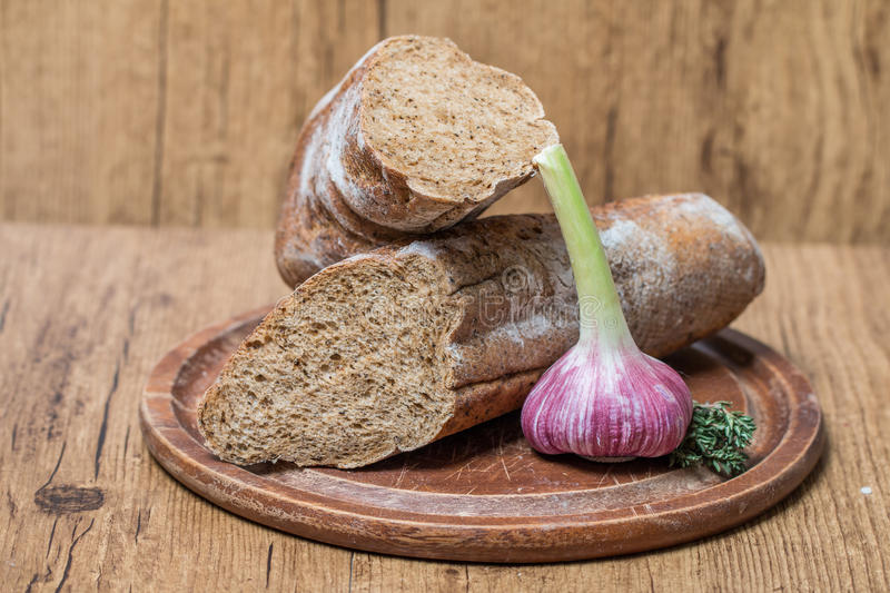 fresh bread baguette with garlic and herbs stock photography