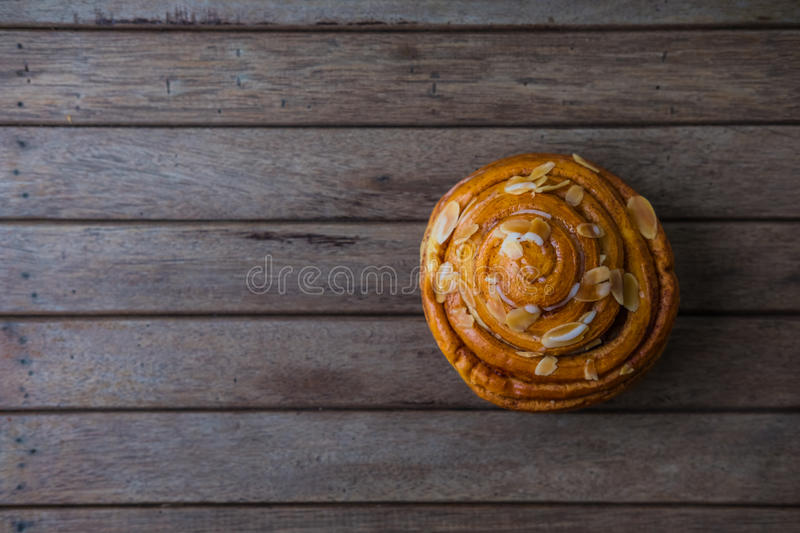 Fresh bread and baked goods on wooden. Chopping board, rustic style royalty free stock image