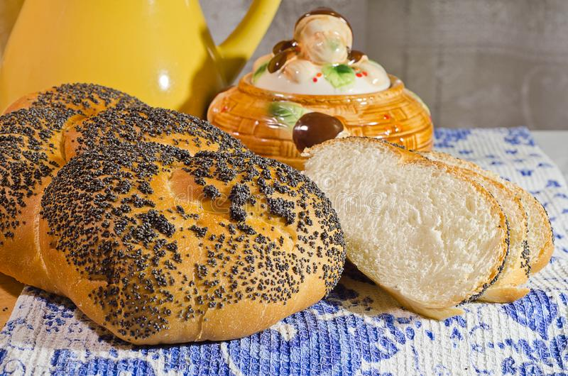 Fresh bread in evening light. Fresh bread with poppyseeds in evening light royalty free stock image