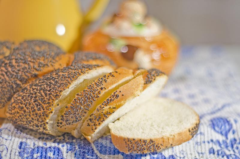 Fresh bread in evening light. Fresh bread with poppyseeds in evening light royalty free stock photos