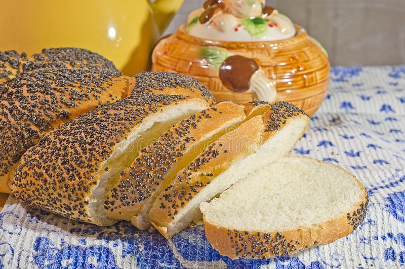 Fresh bread in evening light. Fresh bread with poppyseeds in evening light royalty free stock photo