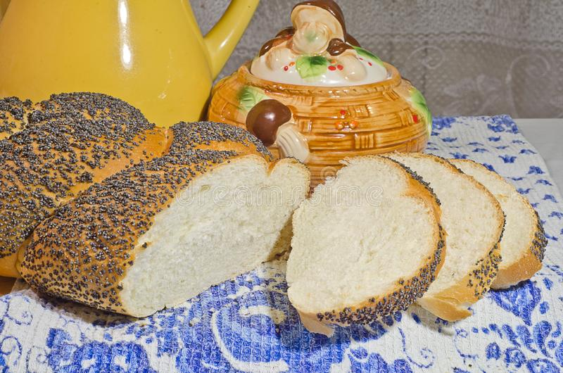 Fresh bread in evening light. Fresh bread with poppyseeds in evening light royalty free stock photography