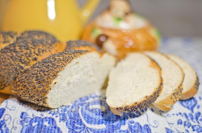 Fresh bread in evening light. Fresh bread with poppyseeds in evening light royalty free stock images