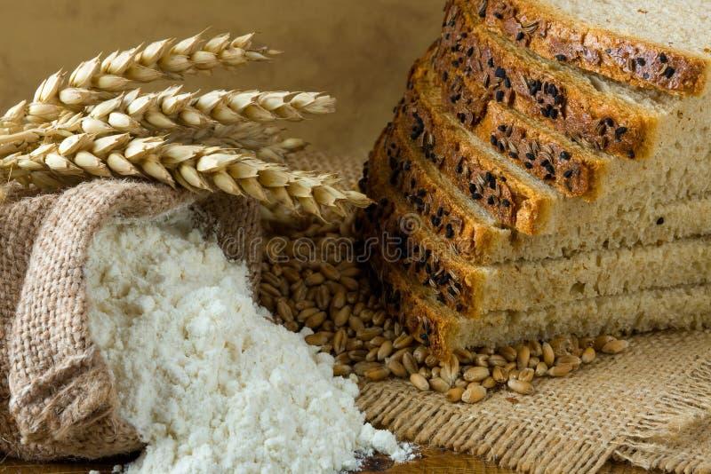 Fresh bread and flour stock photo