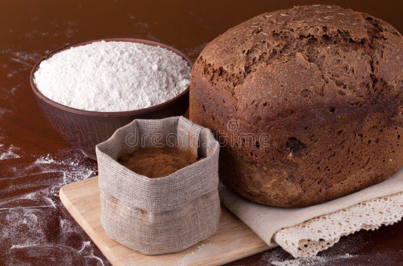 Fresh bread with flour and malt royalty free stock photos