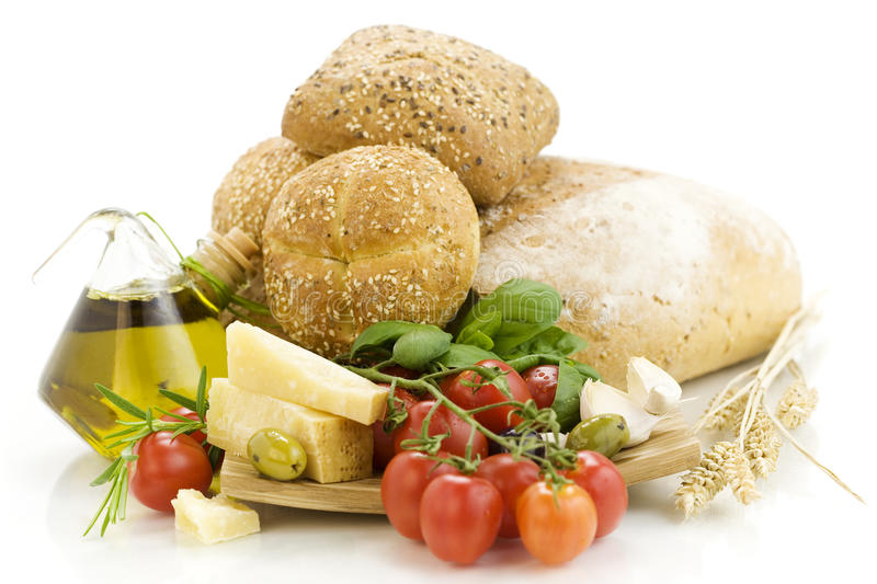 Fresh bread, herbs and vegetables stock photos