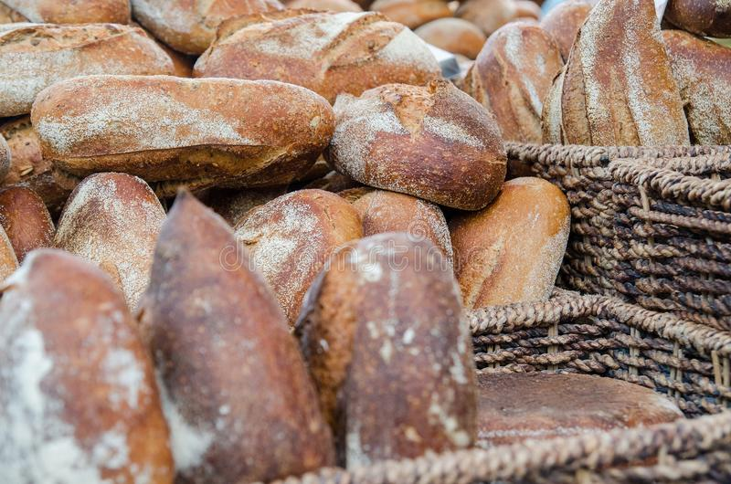 The fresh bread on market. The fresh bread in baskets for sale at city market royalty free stock photos
