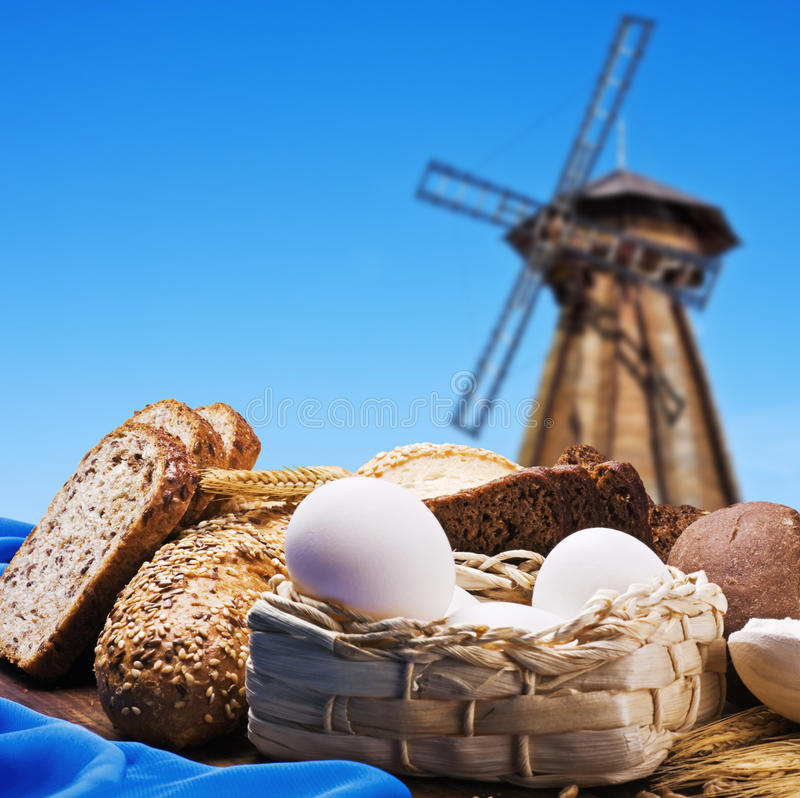 Free Fresh Bread On The Background Of The Wooden Mill Royalty Free Stock Image - 30192056