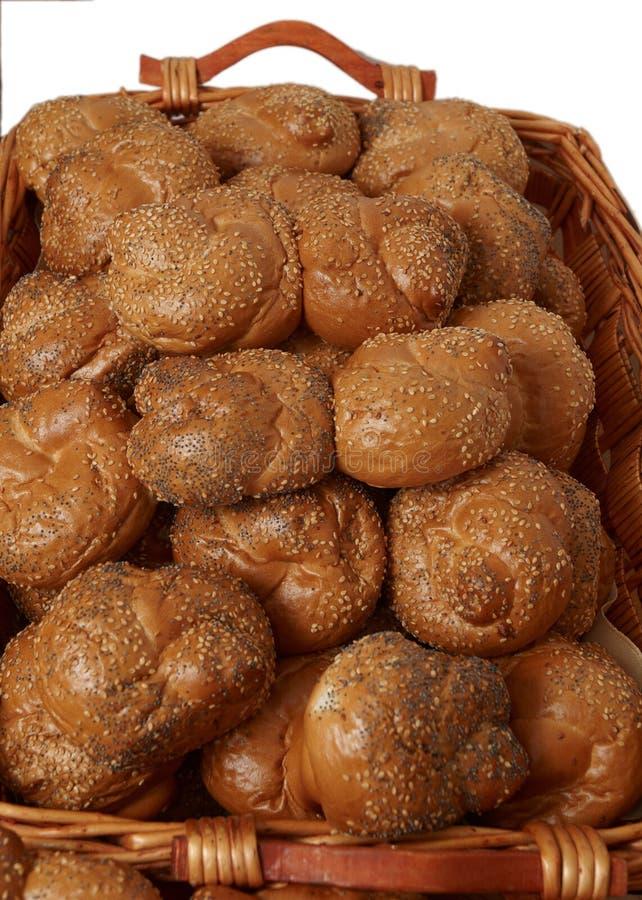 Fresh bread rolls. Fresh bread rolls in a wicker basket on a white background stock photography