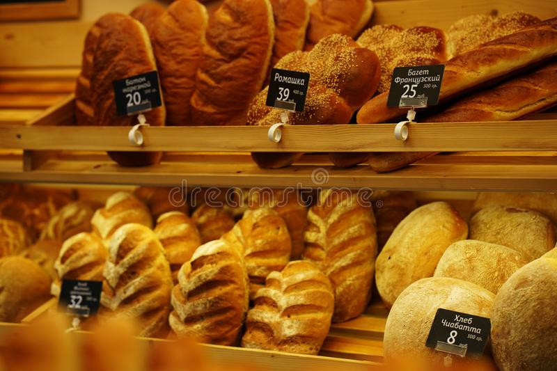 Fresh bread and rolls on the shelf in the store. Background stock image