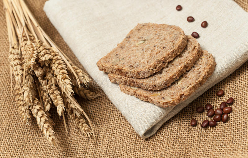 Fresh bread slices with whole grain and wheat. Bread slices with whole grain and wheat royalty free stock photo