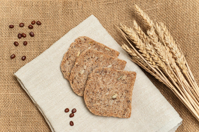 Fresh bread slices with whole grain and wheat. Bread slices with whole grain and wheat stock photography
