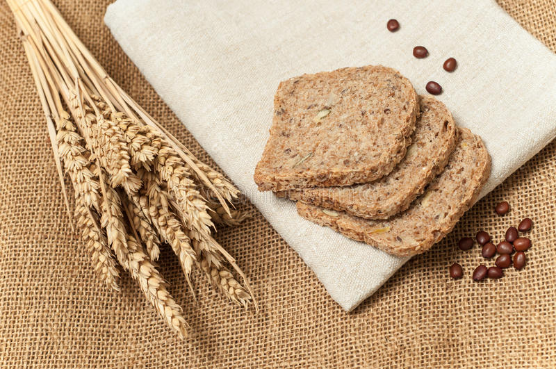 Fresh bread slices with whole grain and wheat. Bread slices with whole grain and wheat royalty free stock images