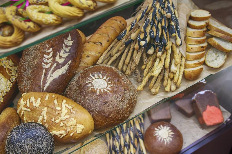 Fresh bread and various buns on the display stock image