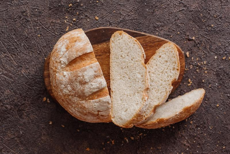 Fresh bread and wheat on the wooden.  royalty free stock photography