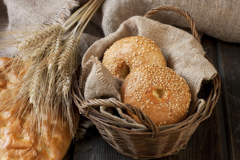 Fresh bread on the wooden background stock photography