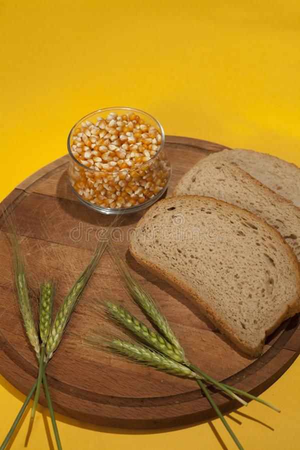 Fresh bread on wooden surface. Fresh bread with yellow Background royalty free stock photo