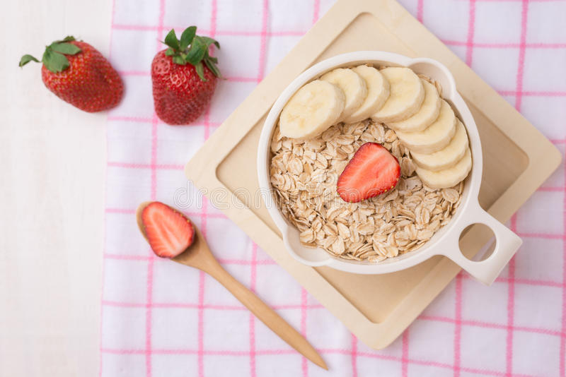 Download Fresh Breakfast Of Healthy Oatmeal With Banana Slices, Strawberr Stock Image - Image: 83706923