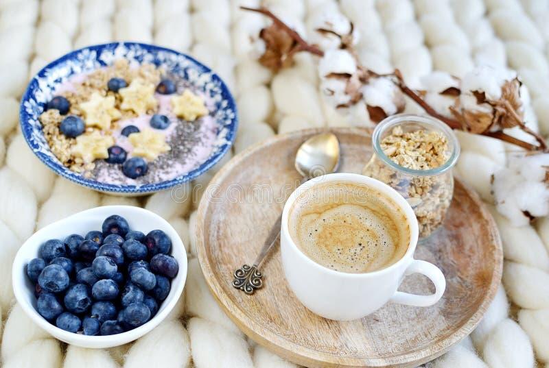 Fresh Breakfast Yogurt with Muesli Banana Berries Chia Seeds Granola. Cotton Flower White Giant Knit Blanket Bedroom Healthy Lifestyle stock photography