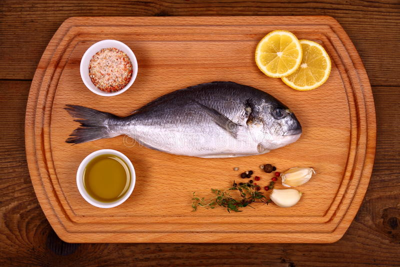 Download Fresh Bream Fish On Cutting Board With Ingredients Stock Image - Image: 37915145