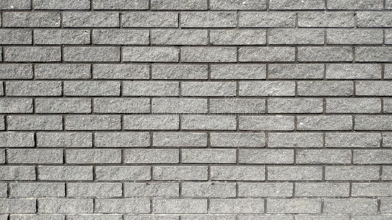 Fresh brickwork from dark bricks. Close-up. Macros royalty free stock images