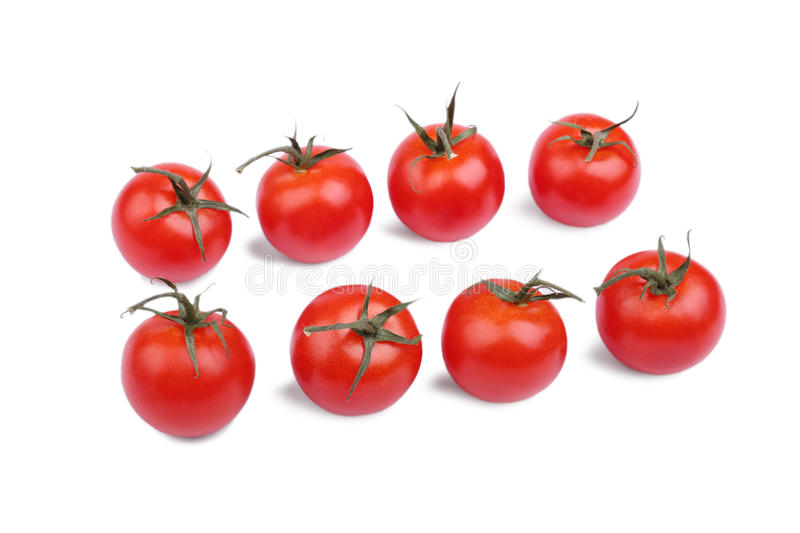 Fresh and bright red tomatoes, isolated on a white background. Set of organic tomatoes. Vegetables for veggie breakfast. stock image