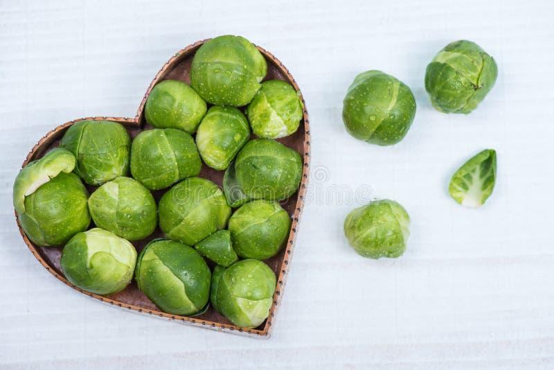 Fresh broccoli in heart shape royalty free stock photos