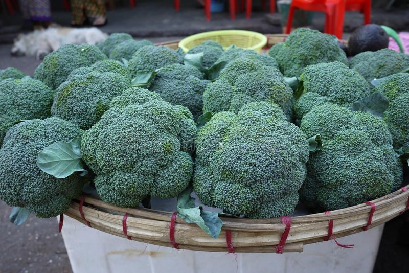 Fresh broccoli street vendor stall at traditional agriculture market. Vegetable retail stock photography