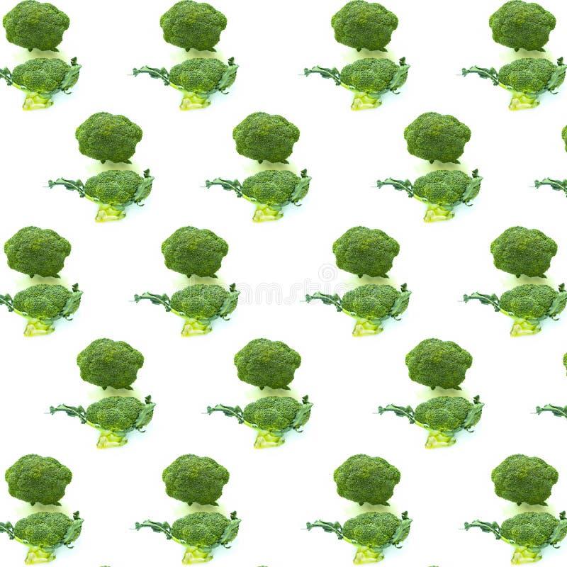 Fresh Broccoli On White Background . Vegetable Pattern. Decorative vegetable pattern. Retro style trendy background ornament with Fresh broccoli vegetables On stock photo